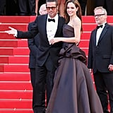 Brad Pitt and Angelina Jolie put on a show for photographers at his May 2011 Cannes Film Festival Tree of Life premiere.
