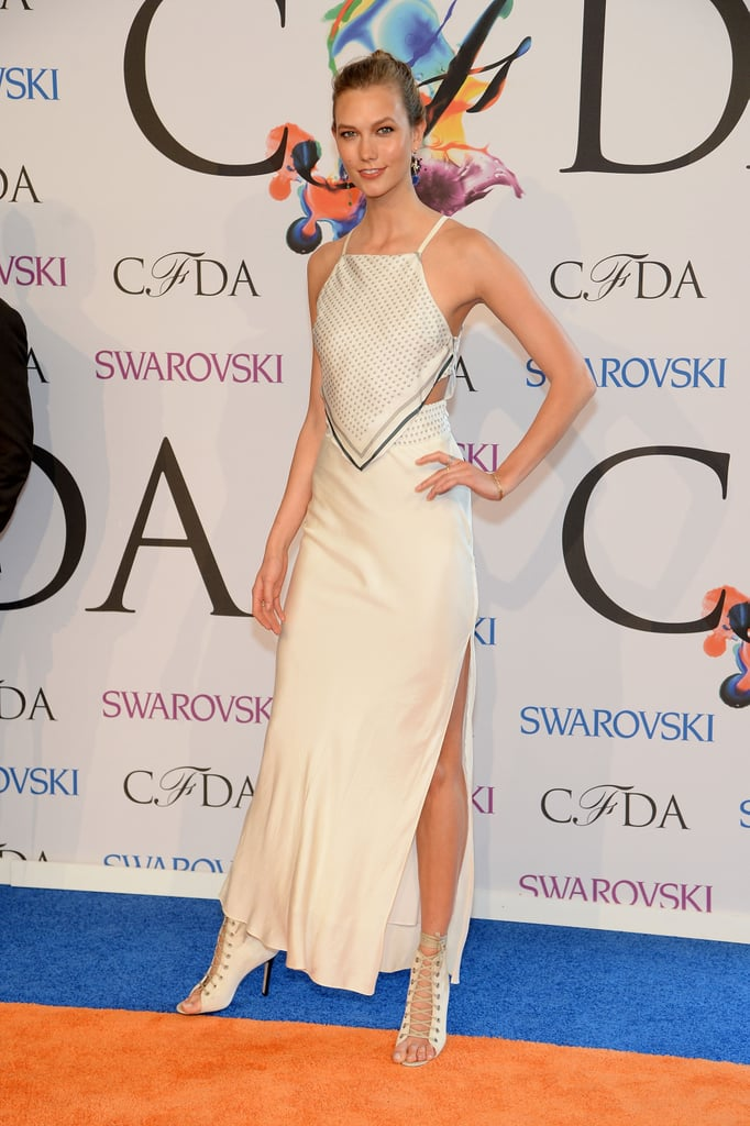 Karlie Kloss wore a cream-colored frock.