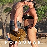 Pierce Brosnan and wife Keely Shaye Smith got a smooch in while on the beach in Hawaii in May 2017.