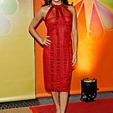 Eva Longoria loves tea-length sheaths and the feeling is clearly mutual, as proven by the fiery Alberta Ferretti she styled for NBC's Upfronts in May 2012. Volumized curls and black satin pumps completed her red-hot look.