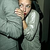Scarlett playfully hid behind a friend at a party in 2004.
