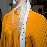 Using a belt as a hair accessory was probably the most unexpected beauty trend to emerge from NYFW, but truth be told, it can totally be pulled off. By looping the belt into itself and pulling it tightly around your hair, you can instantly create a stylish low ponytail. Or just preorder this one from the actual Tibi runway.