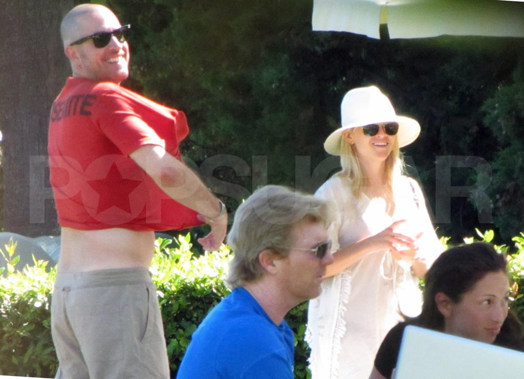 Reese Witherspoon and Jim Toth hang out by the pool.
