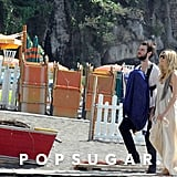 Tom Sturridge had baby Marlowe in a papoose while Sienna Miller walked beside them in Positano.