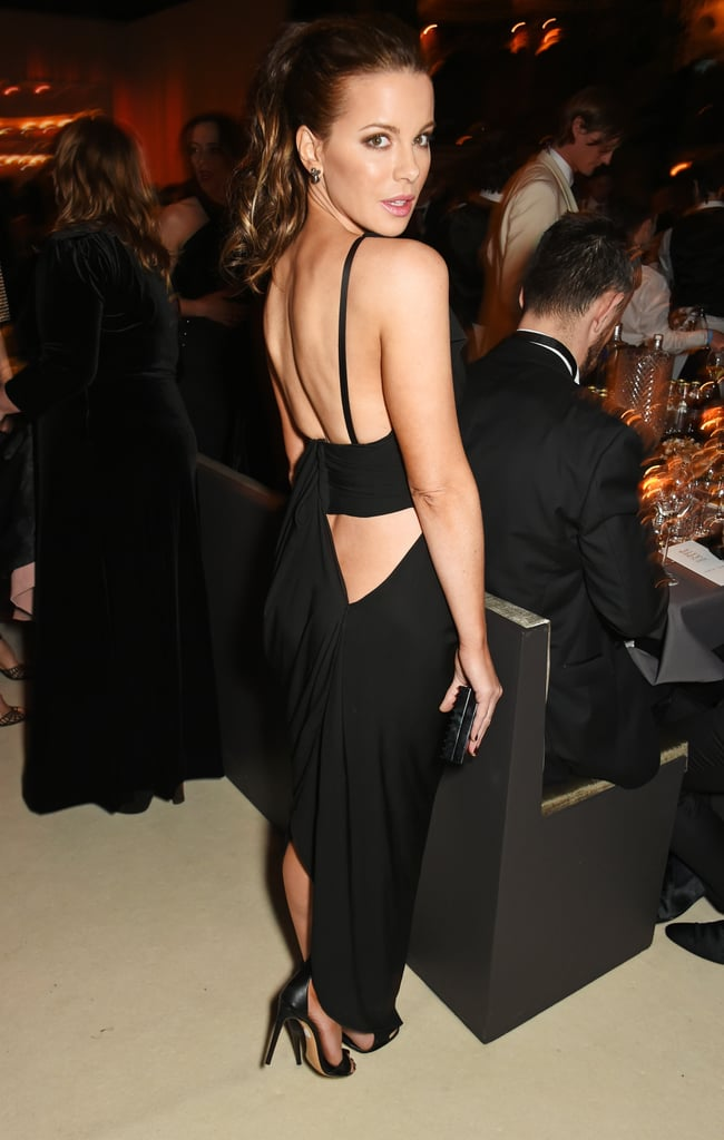 Kate Beckinsale made a scorching hot appearance at the British Fashion Awards in London on Monday. The 42-year-old actress posed for photographers and signed autographs on the red carpet before making her way inside the party, which boasted a guest list that included stars like Lady Gaga and Victoria Beckham, who was joined by her husband, David Beckham. The chic outing comes during a pivotal time for Kate, who stepped out without her wedding ring on Sunday, after reports surfaced that she had separated from her husband of more than a decade, Len Wiseman. Keep scrolling for more pictures of Kate's sexy night out, and then relive her hottest moments of all time.