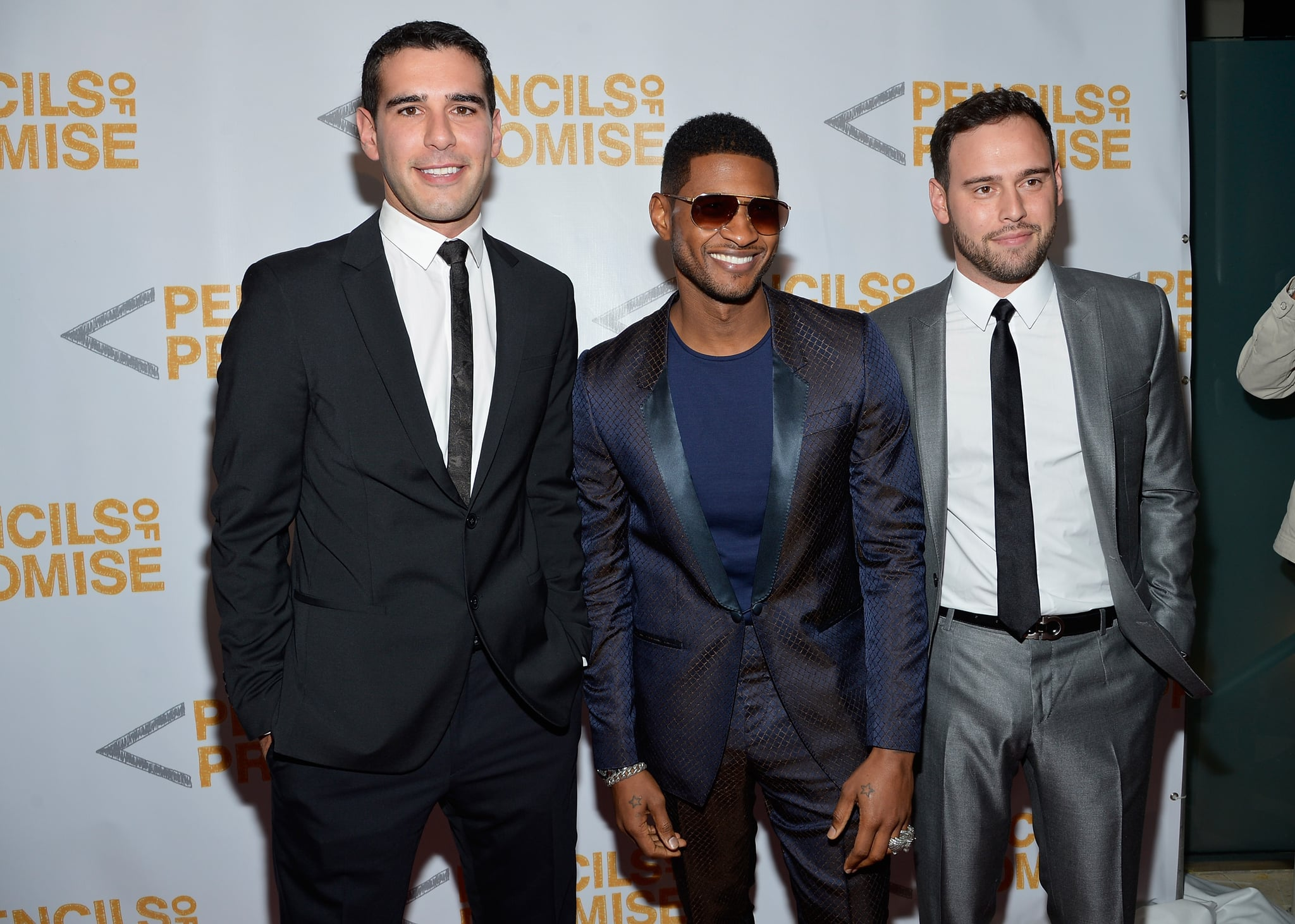 Usher posed with Scooter Braun and Adam Braun on the red carpet.