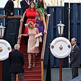 Dave Clark, Prince Harry, Prince William, Kate Middleton, Princess Eugenie, Princess Beatrice, and Sophie of Wessex leave the Royal Yacht Britannia.