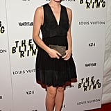 For The Bling Ring screening in NYC, Emma Watson spiced up her little black dress with a Salvatore Ferragamo box clutch, striped pumps, and Monique Péan jewels.