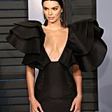 Kendall attended the 2018 Vanity Fair Oscars afterparty in a Redemption minidress with voluminous sleeves that still didn't take away from the glamour of her Lorraine Schwartz chandelier earrings and wrap-around gemstone ring.