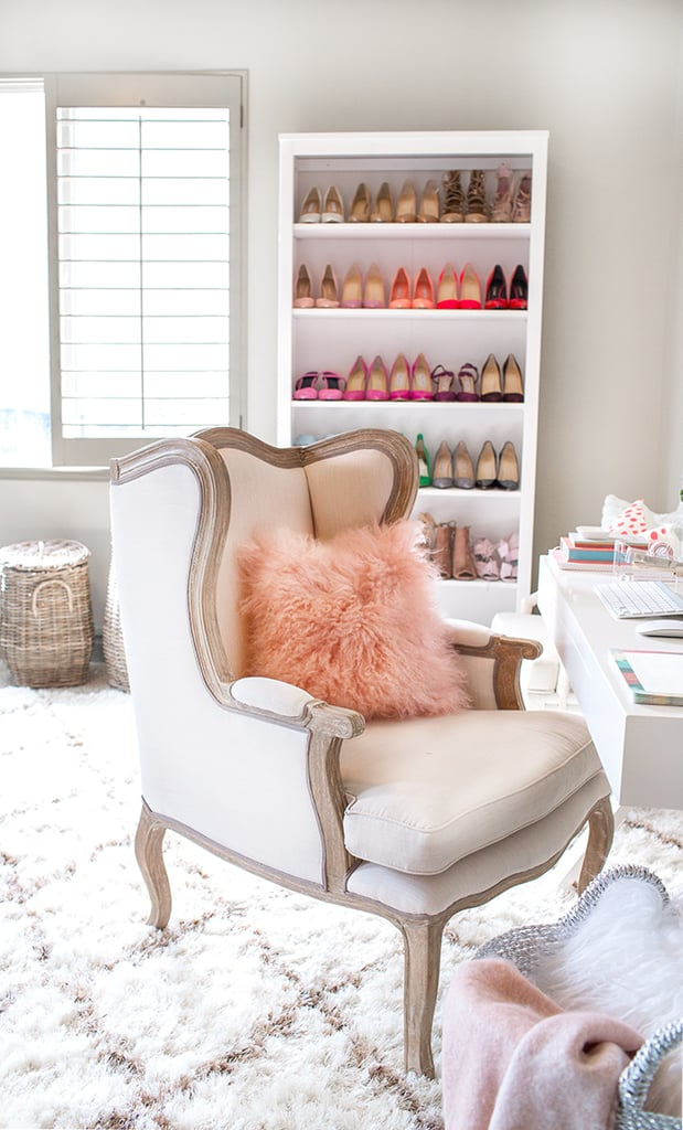 What could be more perfect in a fashion blogger's office than a bookshelf full of color-coordinated stilettos?