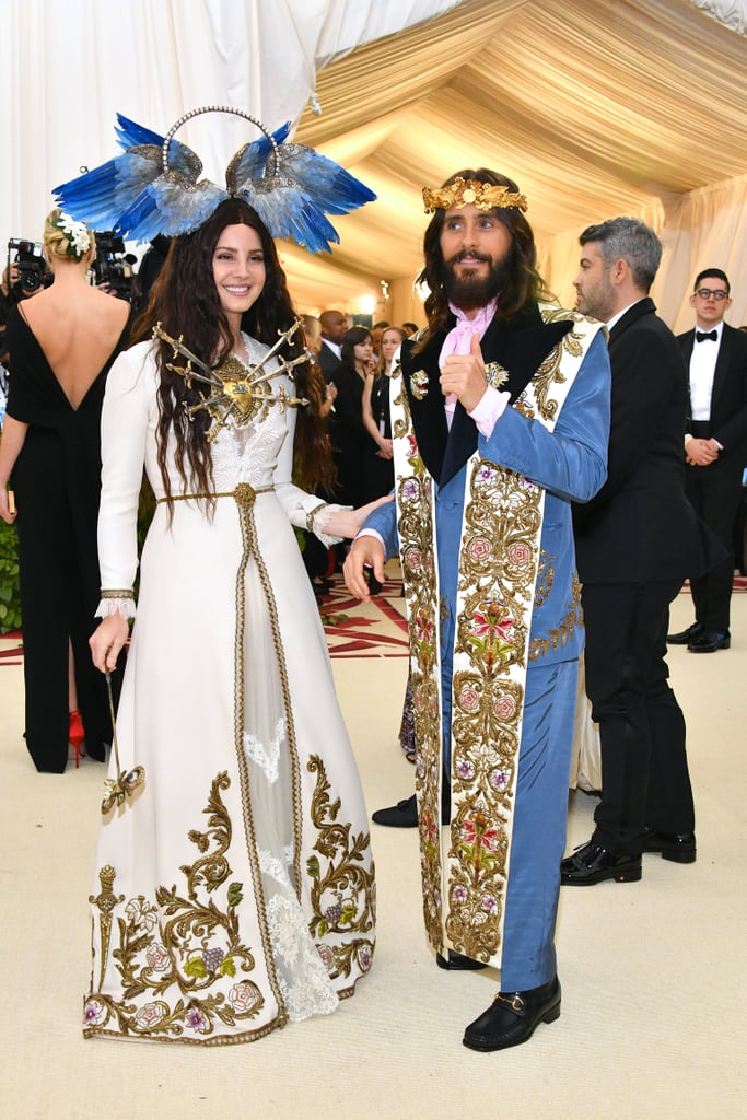 "When this year's Met Gala theme was announced as ""Heavenly Bodies: Fashion and the Catholic Imagination,"" Jared Leto probably didn't bat an eye; even though the Oscar winner and Thirty Seconds to Mars singer has drawn comparisons to Jesus quite a bit over the years — that long hair and bushy beard really do the trick — Monday night's event was a really fun way for him to shine. Jared hit the red carpet in a blue suit, which he topped with an intricate clergy stole and, of course, a gold crown. The 46-year-old had to know how biblical he looked. He flashed a thumbs-up while posing for photos with Lana Del Rey and Gucci designer Alessandro Michele, who crafted their looks."
