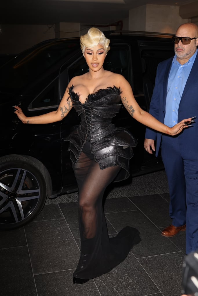 """Strap on your heels and touch up your lip gloss because Cardi B came ready to battle at Paris Fashion Week this year. After turning heads in a feathery red dress from the 1995 Mugler autumn couture collection, Cardi executed another showstopping entrance outside her hotel in France, and the corset on her most recent gown basically doubles as a suit of armour.  Like a vision of Catwoman ready for the red carpet, Cardi came prepared in a 1997 Mugler spring dress with a mesh floor-length skirt. Over the skirt, the textured bustier was layered like the panels on a knight's armour and lined with feather trim. The outfit even comes equipped with removable sleeves — ya know, in case the need to strike a pose became critical. While the look, styled by Kollin Carter, seemed to be missing a sword, we definitely noticed the """"Up"""" singer's sharp black manicure, aka her Catwoman claws for the night, which made the look truly purr-fect. Take a peek at Cardi in the vintage Mugler gown here.      Related:                                                                                                           Rosé Taking Shots Before Looking So Chic at the Saint Laurent Show Is Why We Bow Down"""