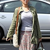 Jennifer Lawrence sported a green jacket with her skirt in LA.