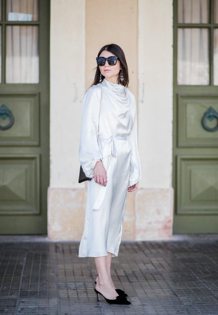 Achieve total elegance in a silk, body-hugging number.
