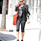 Nicole Richie layered a black, studded leather jacket over her gym clothes.