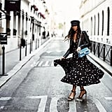 A Newsboy Cap and Leather Jacket Make Your Breezy Summer Dress Fall-Appropriate