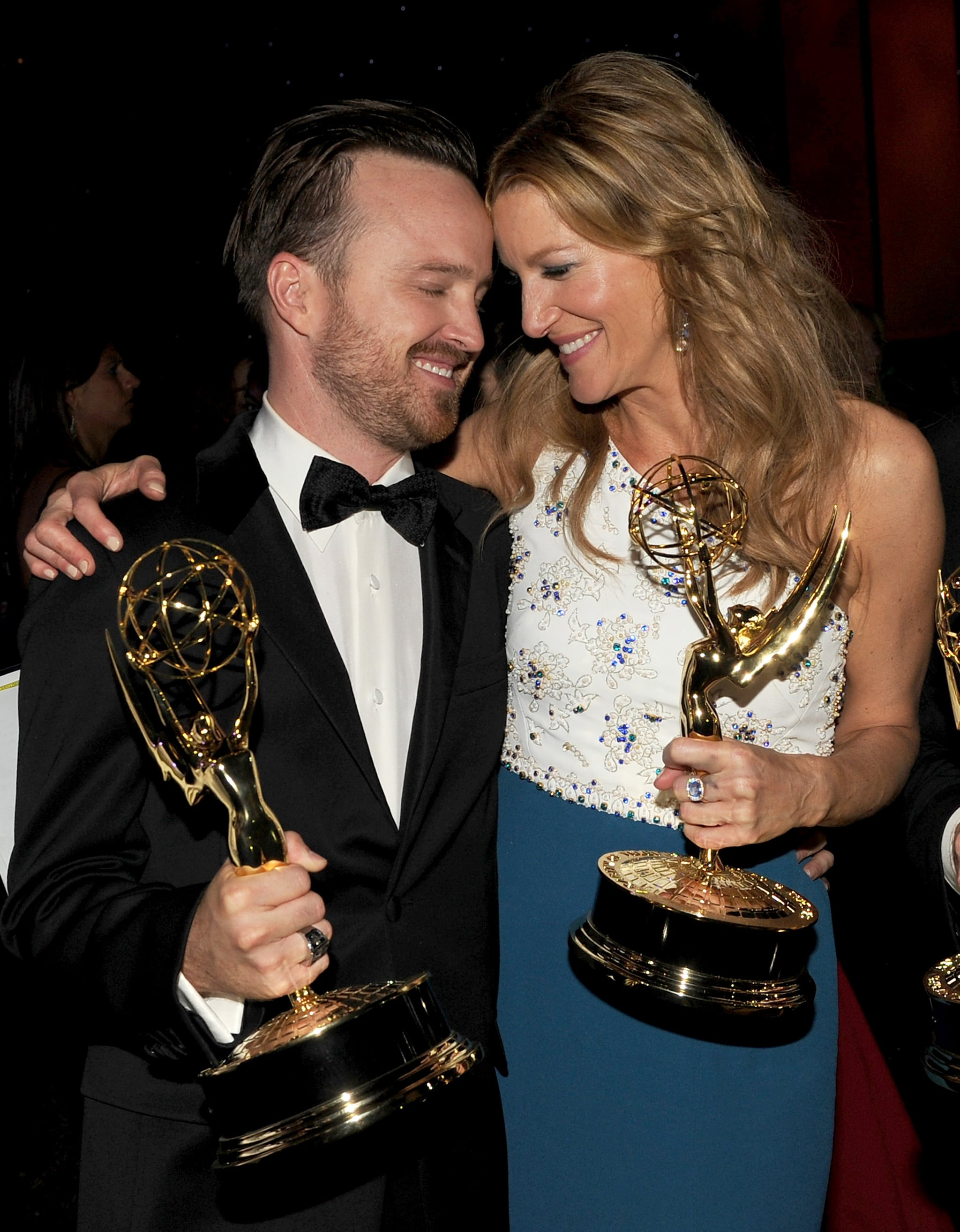 Aaron Paul and Anna Gunn held on to their trophies after winning big for Breaking Bad.