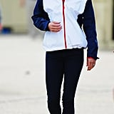Kate's teamed a Team GB tracksuit top with skinny jeans and red trainers.