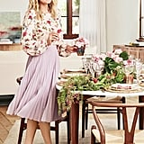 Lauren tells Good Housekeeping that fancy china is one of her entertaining essentials. She layered different plates to create a rich table setting amidst a soft holiday palette of metallics and berry hues.