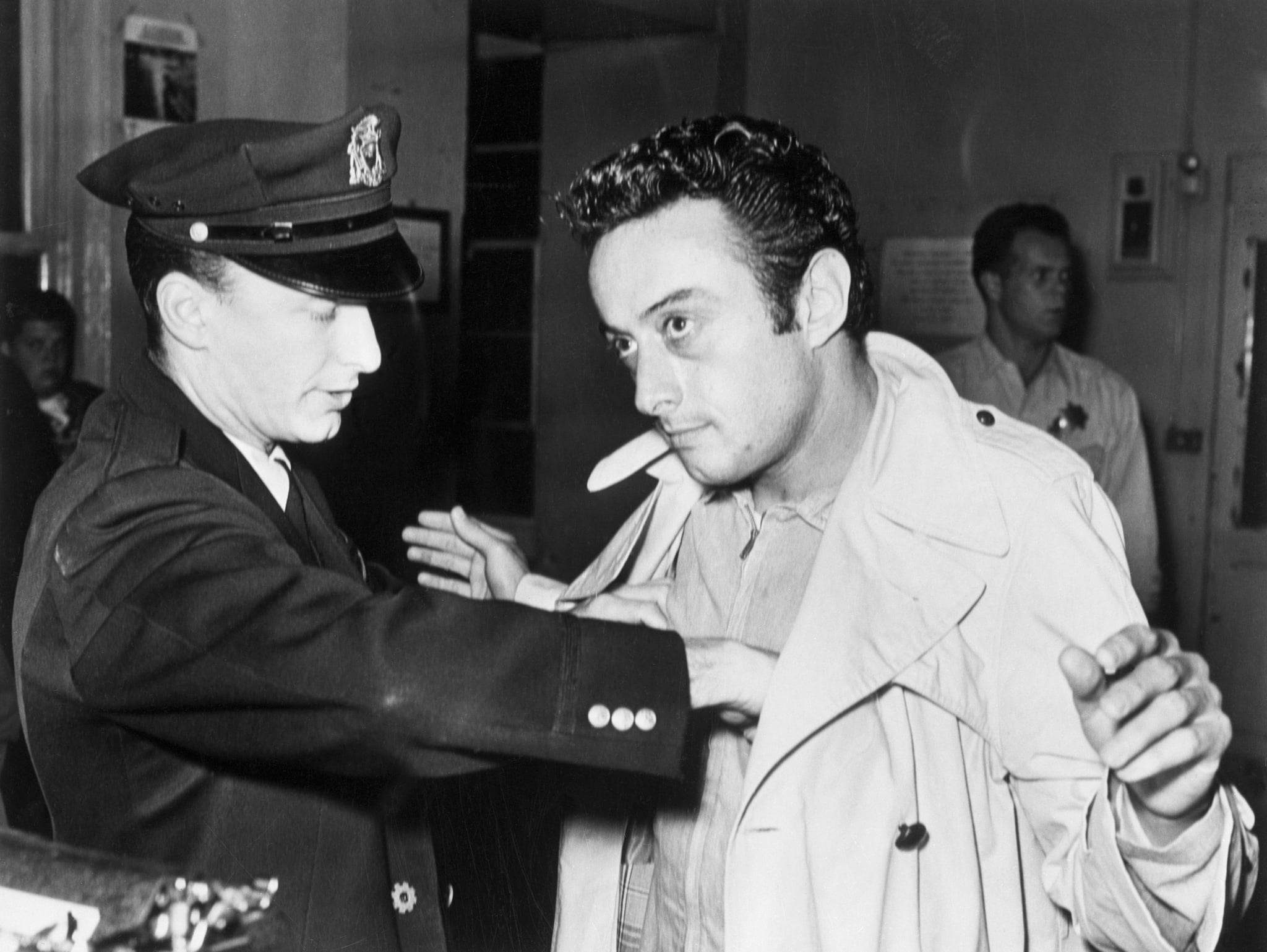 A policeman searches comedian Lenny Bruce after Bruce's arrest for allegedly using obscene language during his act in a North Beach nightclub, the Jazz Workshop. San Francisco, California.