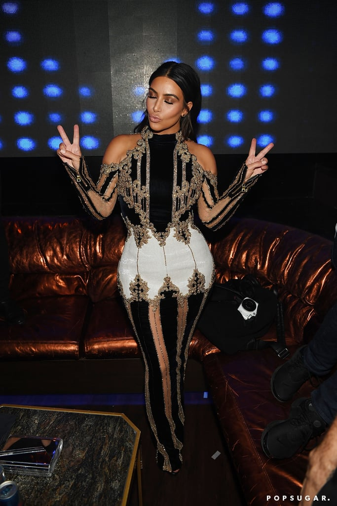 """Kim Kardashian is one hot mama! On Friday night, the reality TV star made a special appearance at Hakkasan in Las Vegas to celebrate the nightclub's third anniversary. Kim, who showed off her post-baby bod in an ultra-glam shoulder-baring, gold-embellished dress, hit the red carpet solo, but was in good company once she made her way inside the venue. Inside, she posed for selfies with fans and mingled with newly engaged model Shanina Shaik and friends Simon Huck, Malika Haqq, and her assistant, Stephanie Shepherd.  Naturally, Kim also took to social media to document her night, uploading a silly group photo on Instagram, writing, """"VEGA$ BABY."""" Meanwhile, on Snapchat, the mother of two revealed she almost didn't make it to Nevada as she encountered some plane trouble while grounded in LA. Fortunately, Kim made it on time and even ended up at Jack in the Box at three o'clock in the morning. Keep reading to see more of Kim, and then check out her recent family getaway in Vail, Colorado."""