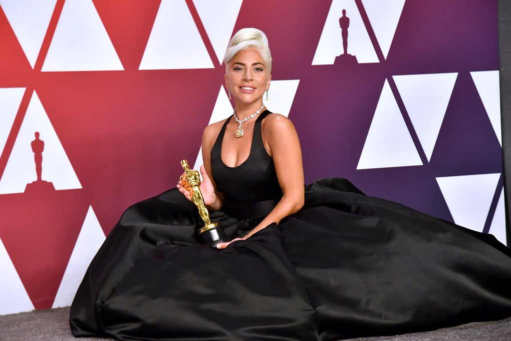 """Lady Gaga was the picture of elegance as she arrived for her big night at the Academy Awards in LA on Sunday. The singer and actress, who won the Oscar for best original song for A Star Is Born, looked stunning in a dramatic black Alexander McQueen gown accessorized with opera-length gloves and a 128.54-carat Tiffany & Co diamond aptly named """"the Tiffany diamond"""" — it's a necklace last worn by Audrey Hepburn in promotional photos for Breakfast at Tiffany's in 1961. In addition to hitting the stage to accept a trophy, Gaga also linked up with her beloved costar Bradley Cooper for a heartwrenching performance of their film's hit theme """"Shallow.""""      Related:                                                                                                           Lady Gaga Came to the Rescue When Rami Malek's Bow Tie Needed Some Serious Straightening               Gaga's exciting night comes on the heels of some slightly less exciting news — the end of her engagement to CAA agent Christian Carino, which was revealed last week. Gaga and Christian dated for over two years before their split, which, according to People, doesn't involve some """"long dramatic story. """"It just didn't work out. Relationships sometimes end,"""" the singer's rep said. Despite the recent breakup, Gaga seemed in great spirits, and why wouldn't she be? She's on top of the world. Keep reading to see all the photos from Gaga's momentous Oscars night!      Related:                                                                                                           This Is How Close Lady Gaga Is to Earning EGOT Status"""