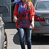 Jessica doubled up on color and print donning a red-and-purple striped Splendid tank with a coordinating scarf and blue ballet flats in LA.