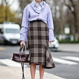 A Striped Button-Down and Check Skirt With White Booties