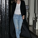 Pairing loose Frame Denim jeans with a white tee, a black coat, and black shoes.