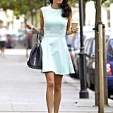 Amal's prim and pleated mint-green dress played up her glow while she ran errands.