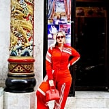 A Coordinated Tracksuit With Cherry Red Accessories