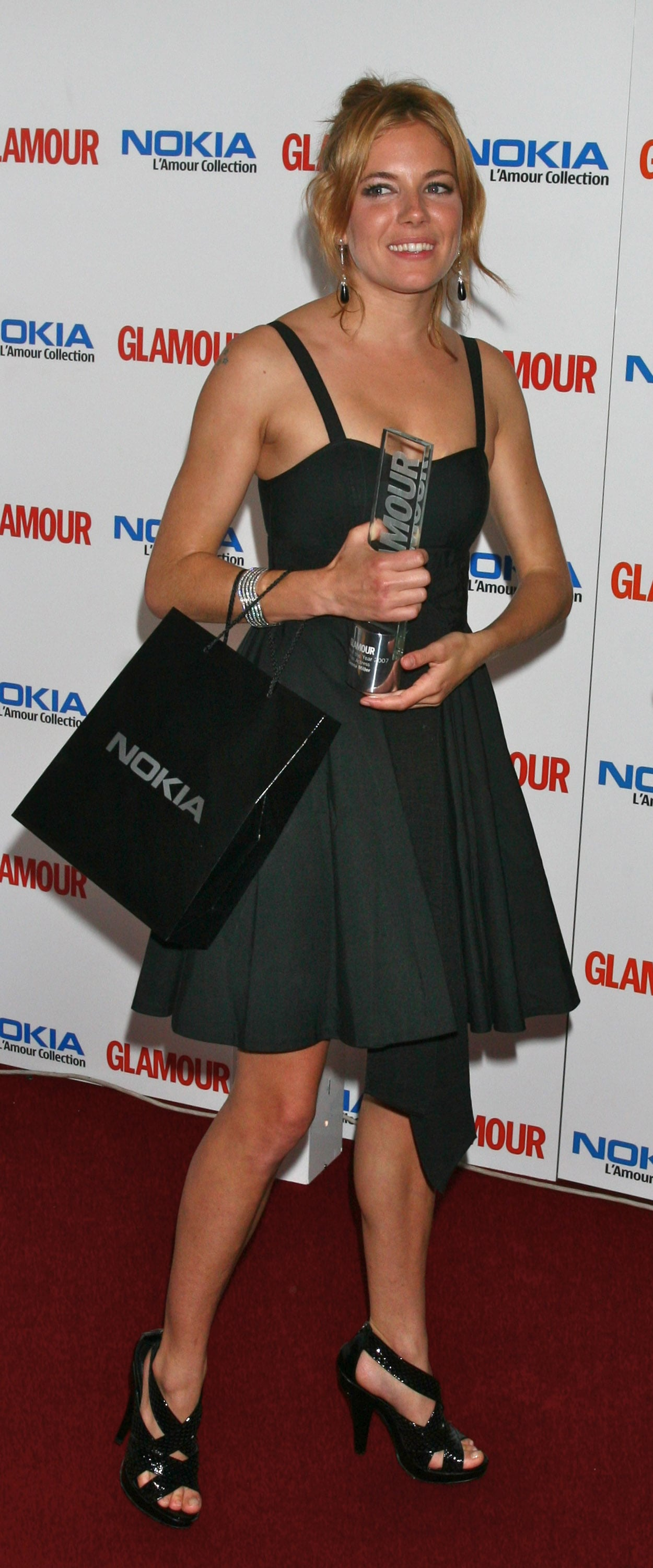 Sienna wore a flirty LBD for the Glamour Women of the Year Awards in 2007.