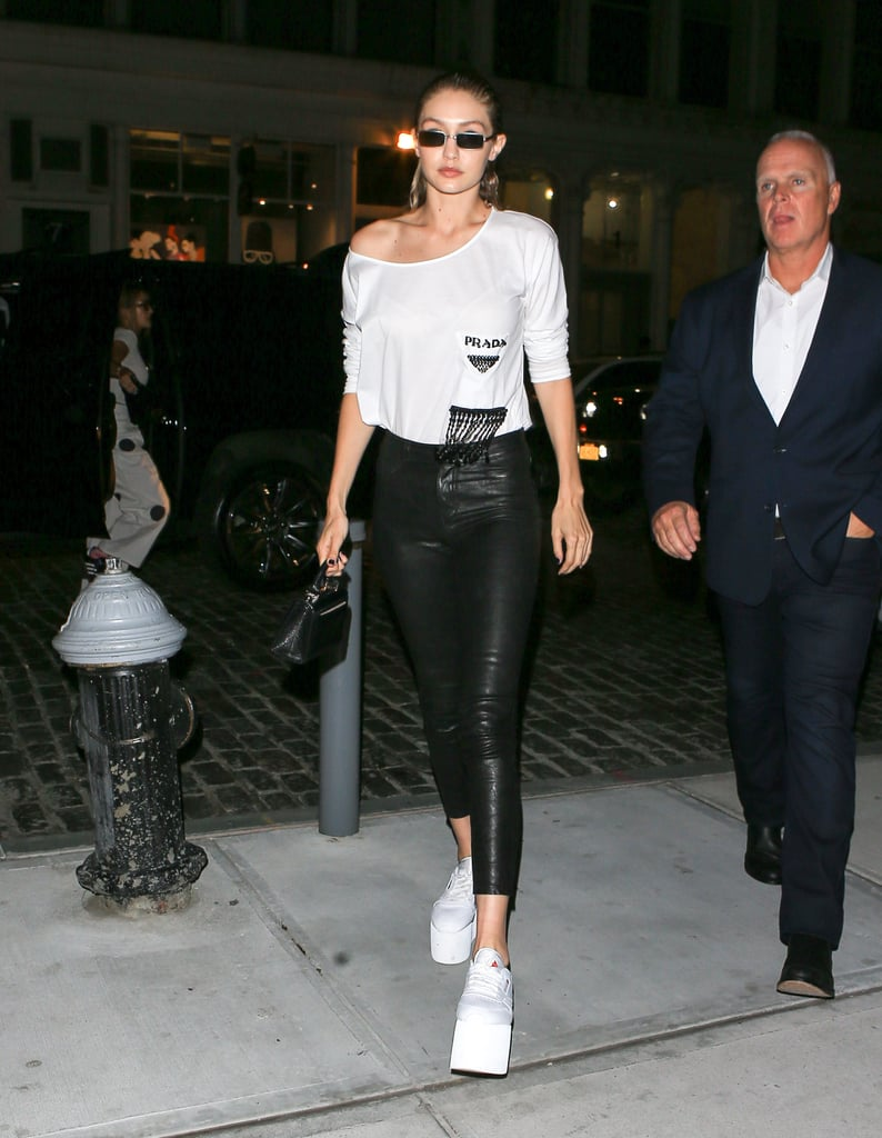 On Sept. 10, the model wore a Prada t-shirt with beaded accents, Paige leather jeans, and Linda Farrow x Dries Van Noten sunglasses. Instead of regular ol' sneakers, Gigi rocked a pair of Reebok platforms.