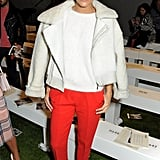 At the Topshop Unique show, Ashley Madekwe kept her top half neutral and bottom half bright in red trousers.