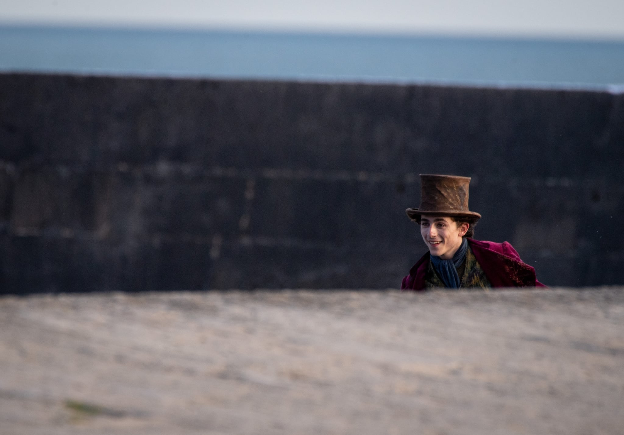 LYME REGIS, ENGLAND - OCTOBER 12: Timothée Chalamet was spotted leaving the ship at the top of a van at the filming of Warner Bros. and the upcoming Roald Dahl Story Company film 'Wonka' on Oct. 12, 2021, in Lyme Regis, England.  This film will focus on young Willy Wonka on his very first adventure and how he met the Oompa-Loompas.  (Photo by Finnbarr Webster / Getty Images)