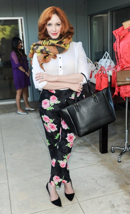 Christina Hendricks mixed patterns with her rose-print bottoms and this Theodora & Callum citron Yucatan scarf ($175), then finished off with a black leather Coach bag at an event in LA.   Source: Stefanie Keenan