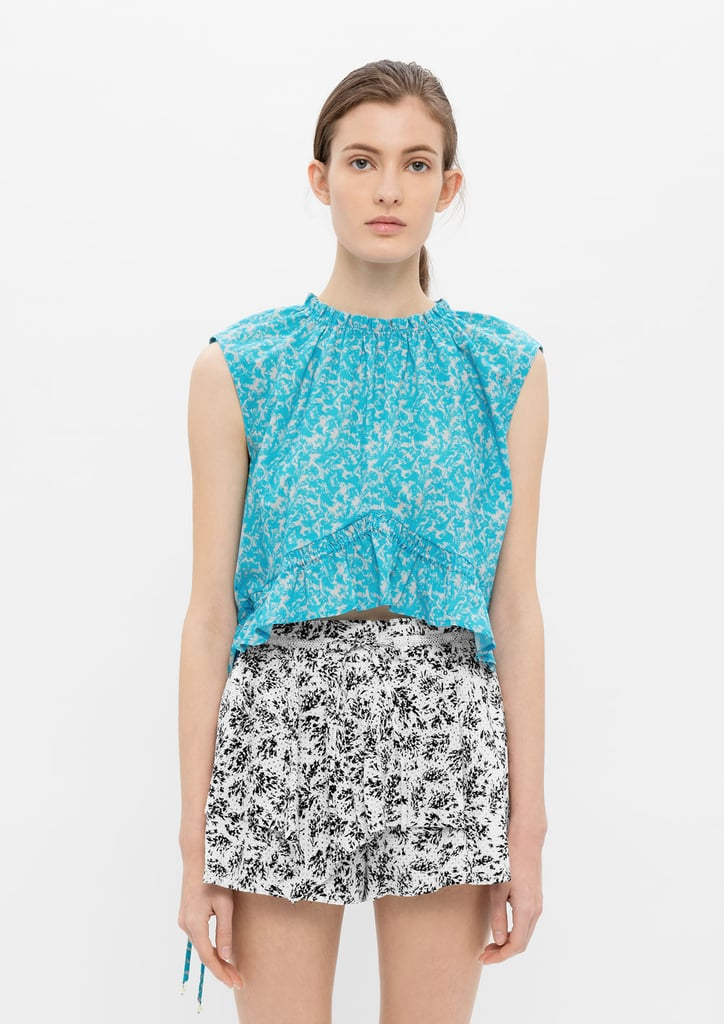 Wear Thakoon's Abstract Print Drawstring Top ($250) with your denim cutoffs.