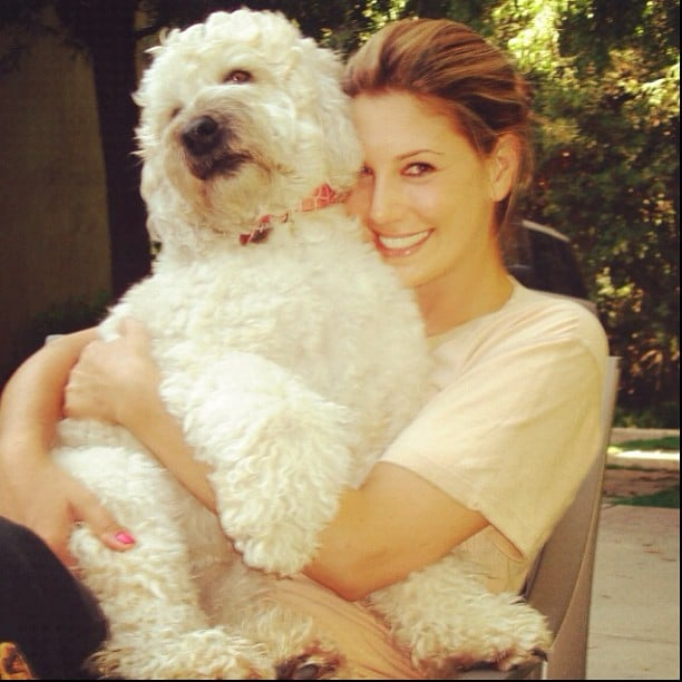 Daisy Fuentes got cozy with her adorable dog. Source: Instagram user daisyfuentes