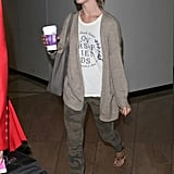 Julianne Hough stayed in neutral territories in camouflage jeans, a white tee, and beige cardigan at the airport.