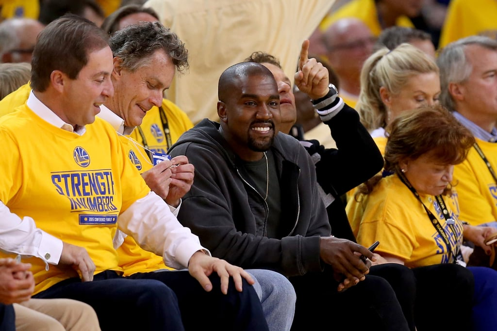 Kanye West made a trip to Northern California on Wednesday to watch the Golden State Warriors play the Houston Rockets in game five of the NBA playoffs at Oakland's Oracle Arena, and unsurprisingly, he had a prime floor seat. Kanye actually managed to crack a smile during the excitement of the Warriors' big win, despite the crowd reportedly booing him when his face popped up on the Jumbotron. Kanye wasn't the only one thrilled about the Warriors moving on to the NBA Finals for the first time in 40 years — NBA MVP Stephen Curry's daughter, Riley, couldn't have been cuter celebrating her dad's victory on the court, and she even made another hilarious appearance at the postgame press conference.