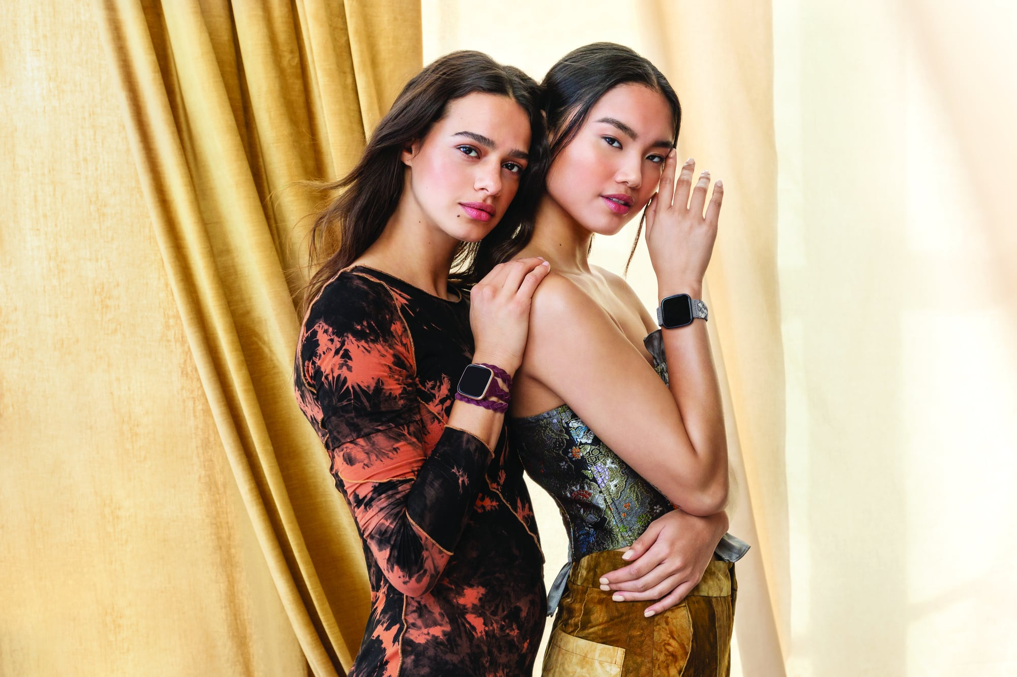Lifestyle photo of Fitbit Mira with Kim Shui accessory band.,,Photographer: Anthony Hudson.