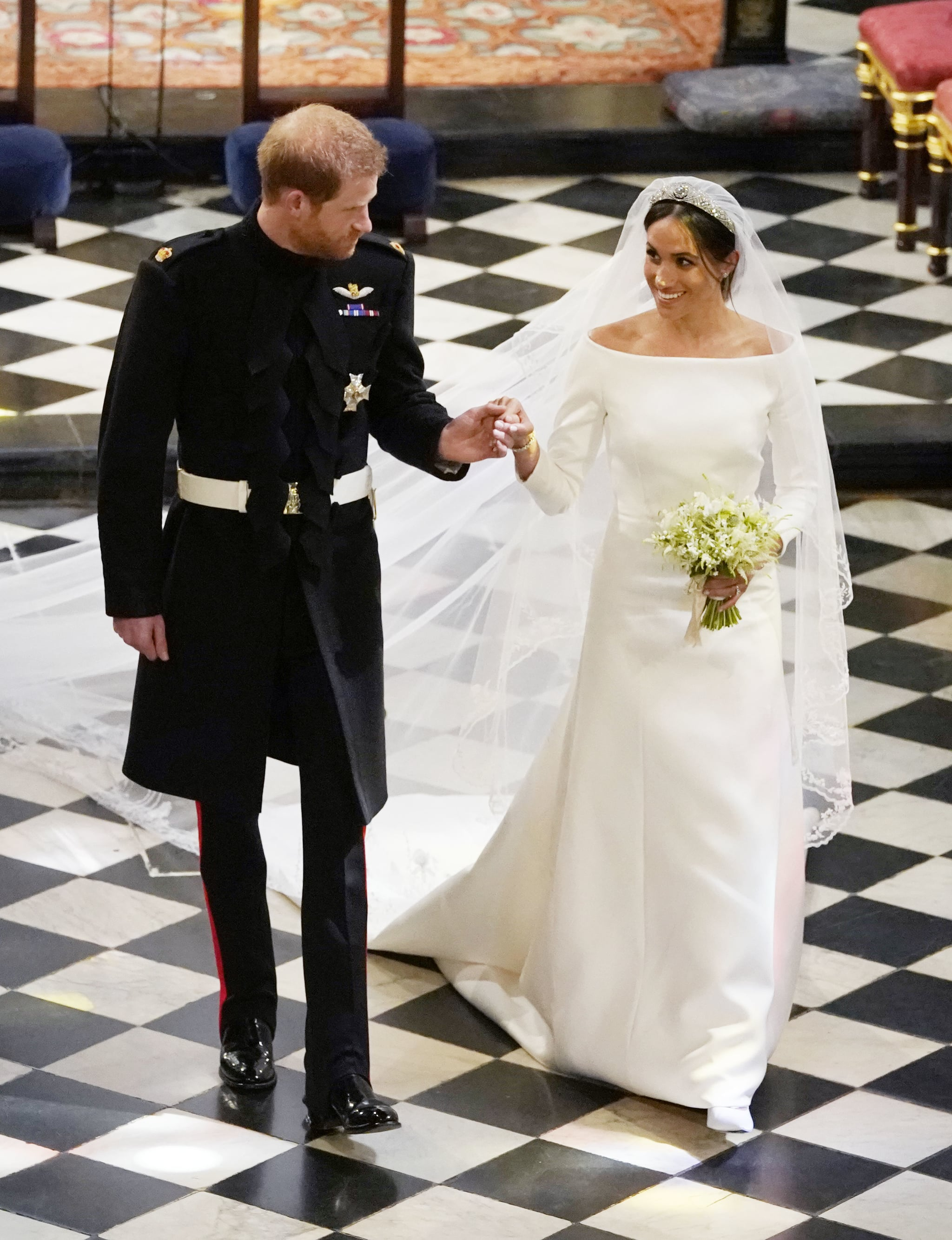 meghan markle and prince harry on their wedding day meghan markle s wedding dress designer shares what it s really like working with the duchess popsugar fashion photo 2 meghan markle and prince harry on their