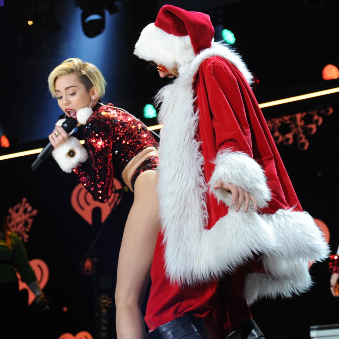 miley cyrus twerked with a christmas tree clad amazon ashley on the miley cyrus at the z100 iheartradio jingle ball in nyc popsugar celebrity photo 16 - Miley Cyrus Christmas