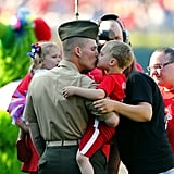 US Army Sgt. Joseph Heim kissed his 4-year-old son Ayden after surprising his family by returning home from a seven-month deployment at an MLB baseball game on June 1, 2013, in Philadelphia, PA.