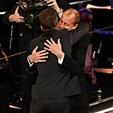 Sam Rockwell hugged his Three Billboards costar and best supporting actor winner Sam Rockwell.