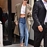 She Also Wore a Tweed Trench Coat, a Crop Top, and High-Waisted Jeans