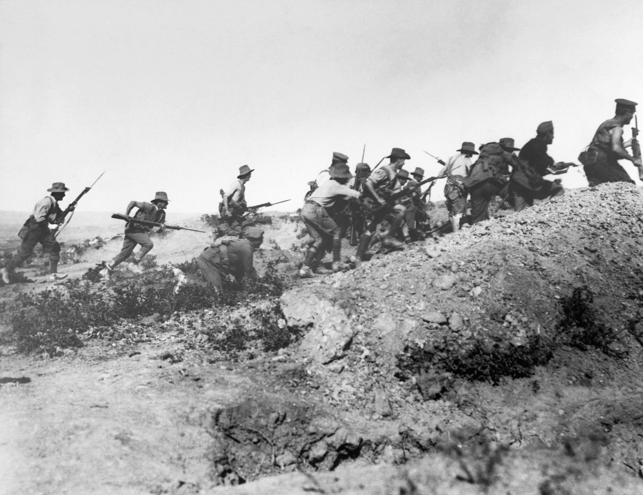Australian troops charge near a Turkish trench just before the evacuation at Anzac. When they got there the Turks had flown. Dardanelles Campaign, ca. 1915. | Location: Gallipoli Penninsula, Turkey. (Photo by © CORBIS/Corbis via Getty Images)