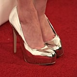 Emma Roberts rocks it from head to toe in these metallic pumps!
