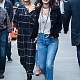 Bella Hadid walked through the streets of New York in light-blue Converse shoes and accessorized her look with layered necklaces.