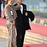 Crown Princess Victoria of Sweden wearing a furry coat and sequined gown.